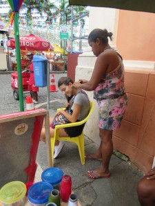 Carlie being braided in Salvador